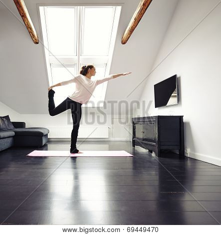 Beautiful Woman Practicing Yoga Exercises At Home