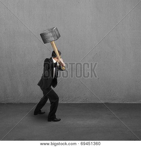 Using Big Hammer To Creak Wall