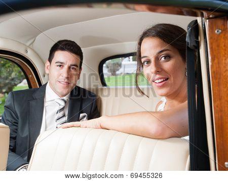 Bride And Groom Inside A Car