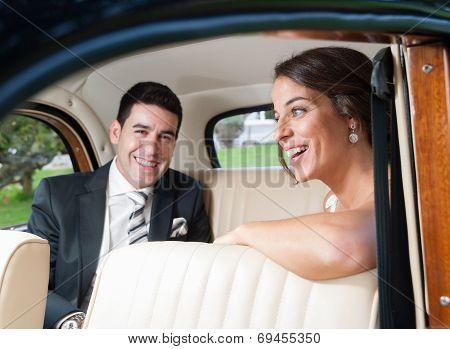 Bride And Groom Inside A Classic Car