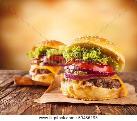 Delicious hamburger served on wood