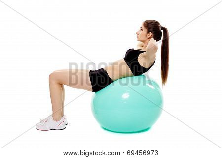 Woman Doing Abs On Gym Ball