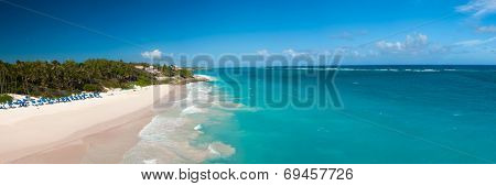 Crane Beach is one of the most beautiful beaches on the Caribbean island of Barbados. It is a tropical paradise with palms hanging over turquoise sea, panorama