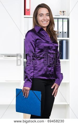 Woman With Blue Folder In The Office