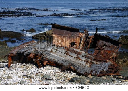 Deteriorating Shipwreck On Coastline