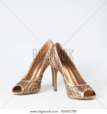 Woman Gold Shoes On Background