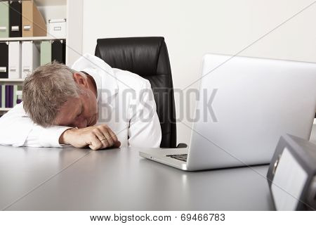 Exhausted Doctor Sleeping On His Desk