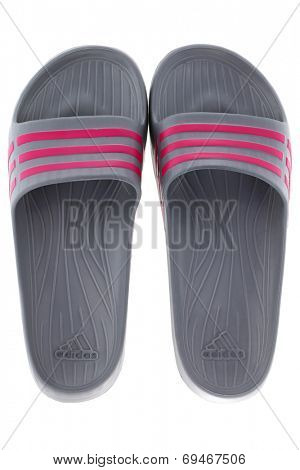 BANGKOK, THAILAND - JULY 2014 : A pair of Adidas Duramo Slide sandals in Graphite with pink stripes isolated on white on 12 July 2014 in Bangkok, Thailand.