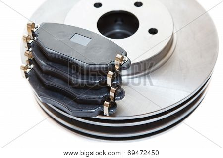 Two Silver Brake Disks And Pads Isolated On White Background