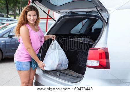 Portrait Of Young Woman Shopper After Mall Near Own Vehicle