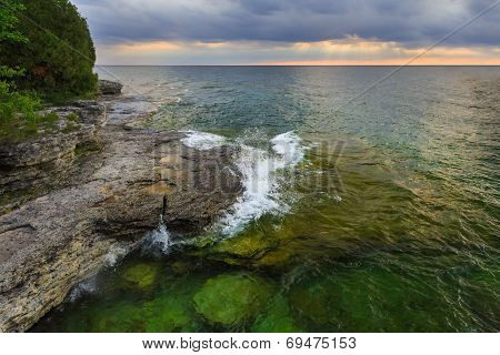 Sunrise Over Rocky Coastline