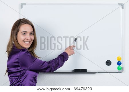 Woman Is Pointing To A Board With A Pen