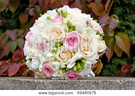Bouquet of white, pink, cream roses for the wedding ceremony.