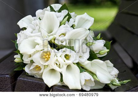 Bridal bouquet of calla lilies and tulips flowers for the wedding ceremony.