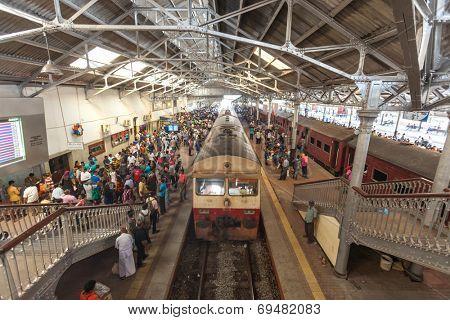 HIKKADUWA, SRI LANKA - FEBRUARY 22, 2014: Crowds waiting on Colombo platform. Colombo is the main hub for all trains in Sri Lanka