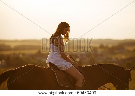 Girl In Dress On A Horse