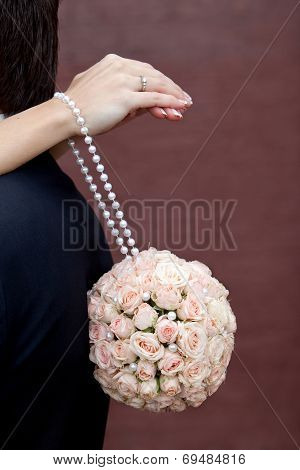 Bouquet of fresh flowers for the wedding ceremony. Bouquet of roses in the shape of a ball hanging o