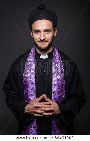 Portrait: young smiling priest