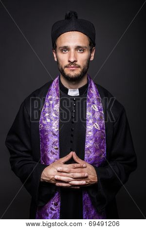Humble catholic priest