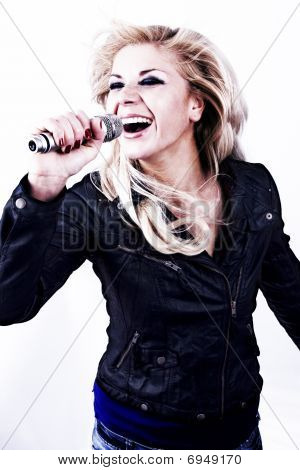 Rock Singer. Young Girl Singing Into Microphone.