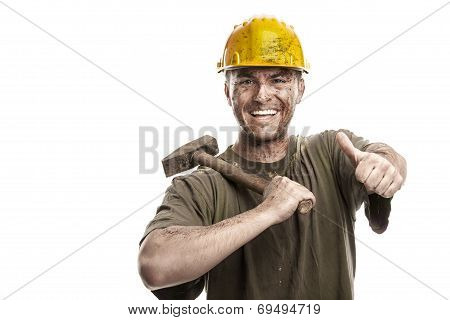 Young Dirty Smiling Worker Man With Hard Hat Helmet  .holding A Hammer, Thumbs Up