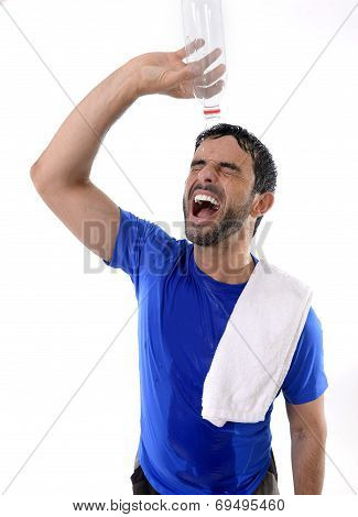 Young Attractive And Athletic Sport Man Exhausted Pouring Water On His Face