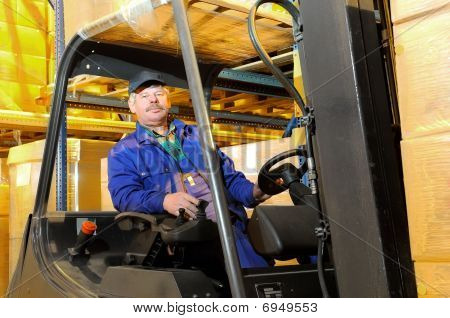 Forklift Worker At Warehouse