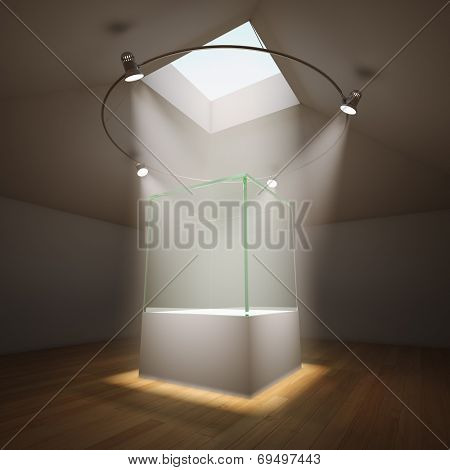 Empty glass showcase in room illuminated by spotlights