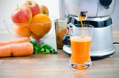 stock photo of juicer  - Juicer and carrot juice - JPG