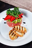 pic of tartar  - Tuna tartare with fruit strawberries and toasted toast shot close-up in a restaurant ** Note: Shallow depth of field - JPG