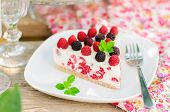 stock photo of fancy cakes  - A Piece of No-bake Fresh Raspberry Cheesecake with Red and Black Raspberries and Melissa Summer Cake