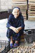 Elderly Woman And Potatoes