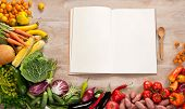 image of eatables  - food photography of open blank notebook surrounded by a fresh vegetables on wooden table - JPG