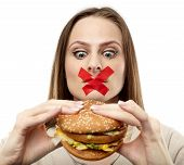 image of junk food  - Young woman with duct tape over her mouth preventing her to eat junk food. Healthy eating concept