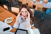 stock photo of canteen  - Girl studying hard at the University canteen - JPG