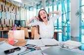 image of canteen  - Girl yawning while studying in the University canteen - JPG