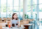 stock photo of canteen  - Girl studying in the University canteen with Fresh and cake - JPG