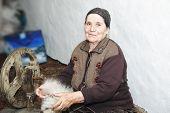 Senior Woman Carding Woolen Yarn