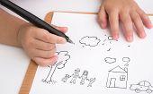 stock photo of preschool  - Preschool age child writing love family - JPG