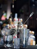 foto of over counter  - Bartender tools at the club over dark background  - JPG