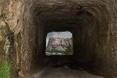 image of mount rushmore national memorial  - view of mount Rushmore from a distant road tunnel - JPG