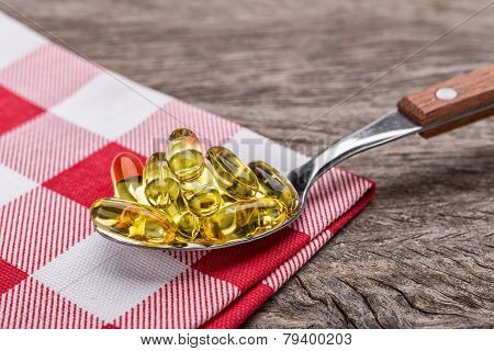 Tablespoon With Dietary Vitamin E Pills. In The Decorative Napkin.