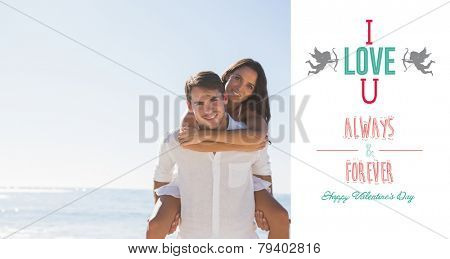 Smiling man giving girlfriend a piggy back looking at camera against cute valentines message