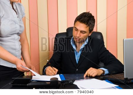 Boss Signing Secretary Documents