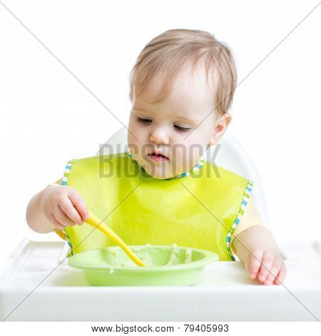 child girl eating singly with a spoon