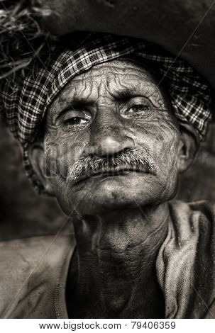 Indigenous senior Indian man looking grumpy at the camera.