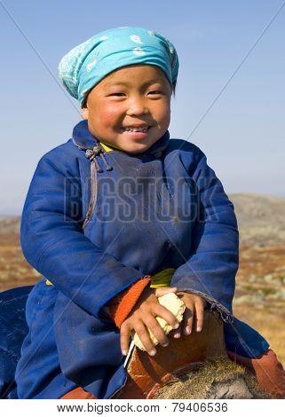 Young Tsaatan girl with a beautiful smile (reindeer people), northern Mongolia.
