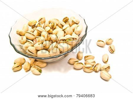 Plate With Tasty Pistachios On White