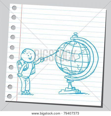 Schoolkid pointing on desk globe