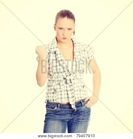 Young angry woman with fist up